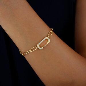 Pulseira com corrente de elos e detalhe cravejado banhada em ouro 18k