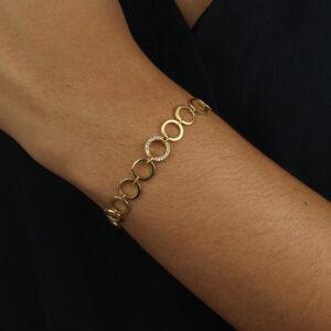 Pulseira de círculos com detalhe cravejado de zircônias cristal ouro 18k